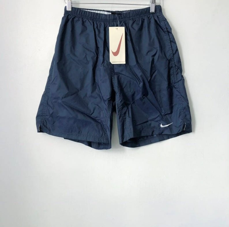 d544bf83dc3d Vintage nike black tag swim trunks mens size medium deadstock