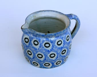 German blue pottery jug with black circles on white background