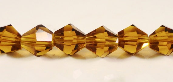 Topaz Crystal Bicones 6mm Dark Topaz Yellow Faceted Chinese Crystal Beads for Jewelry Making on a 11 1/4 Inch Strand with 50 Beads