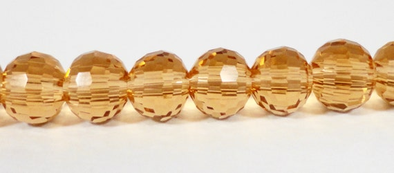 "Yellow Crystal Beads 6mm Round Golden Honey Micro Faceted Disco Ball Style Chinese Crystal Glass Beads on a 6 3/4"" Strand with 33 Beads"