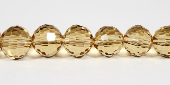 """Yellow Crystal Beads 8mm Round Champagne Yellow Multi Faceted Disco Ball Style Chinese Crystal Glass Beads on a 9 1/2"""" Strand with 33 Beads"""