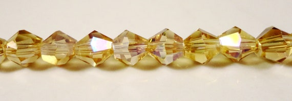 Yellow Crystal Bicones 6mm Golden Yellow AB Faceted Chinese Crystal Beads on an 11 Inch Strand with 50 Beads