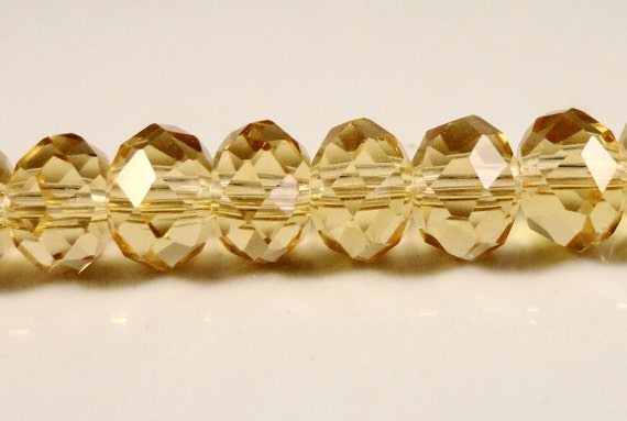 Yellow Rondelle Crystals 8x6mm Golden Champagne Yellow Faceted Chinese Crystal Glass Beads on a 7 1/2 Inch Strand with 35 Beads USA Seller