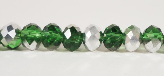 "50pcs Rondelle Crystal Beads 6x4mm (4x6mm) Half Grass Green Half Metallic Silver Chinese Crystal Glass Beads on an 8 1/2"" Strand"