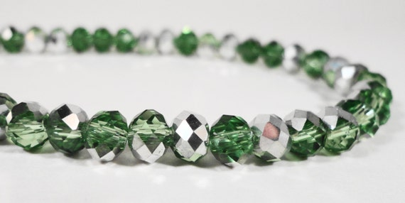 """Rondelle Crystal Beads 6x4mm (4x6mm) Half Metallic Silver Half Peridot Green Chinese Crystal Glass Beads on an 8 3/4"""" Strand with 49 Beads"""
