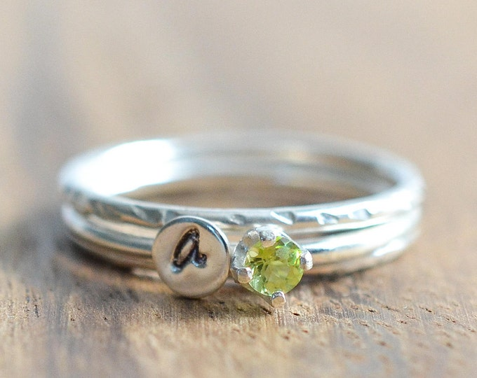 Featured listing image: Sterling Silver August Birthstone and Any Initial Stacking Ring Set // Peridot Ring // Set of 3 Birthstone and Letter Stacking Rings