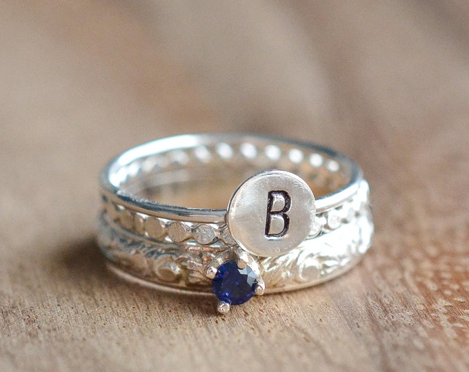 Featured listing image: Sterling Silver September Birthstone and Any Initial Stacking Ring Set // Sapphire Ring - Set of 3 Birthstone and Letter Stacking Rings