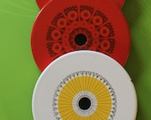 Cool vintage enamel stove top covers trivets by Finel, Arabia Wartsila, Finland