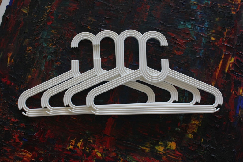 made by Karhumuovi Finland Truly and sincerely retro and cool designer white plastic hanger set of 4