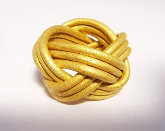Gold braided leather ring
