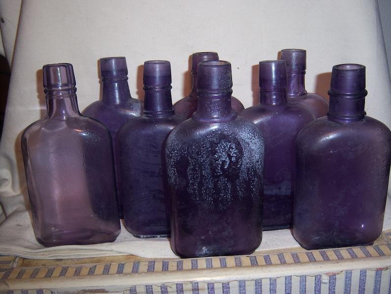 7524f70e12b7e5 1900-10 s Lot of 8 Purple Whiskey Liquor Half Pint Flasks