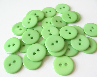 36 green plastic buttons 2 hole 15mm
