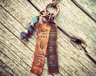With brave wings she flies necklace ; graduation