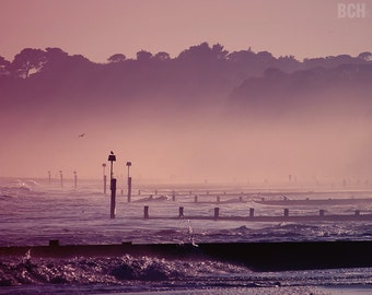 Purple Mist. Foggy sunset, splashing waves on the beach. Colour and black&white version available