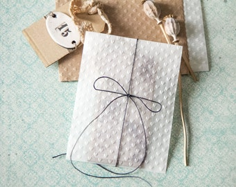 Embossed white glassine bags for wedding, hearts embossed bags