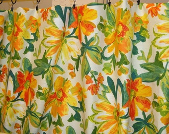Floral Mill Creek fabric by the yard. Orange yellow flowers with a green leaves on white background.100% cotton.