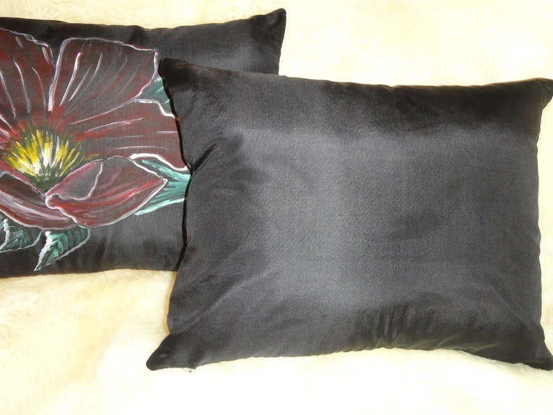 Red flowers with green leaves on black background.Size is 16x20.Zipper closure. Habotai silk A pair of  hand painted pillows