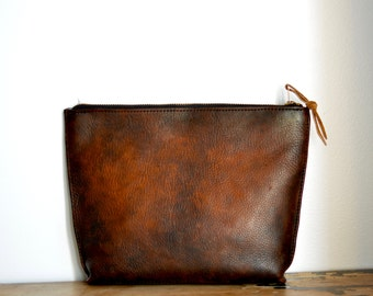 Distressed clutch pouch