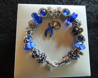 by TLCcharms FAMILY ANGEL...Silver Charm Bracelet with Aqua and Pink European Beads..