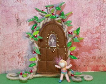 Fairy door with tiny fairy.