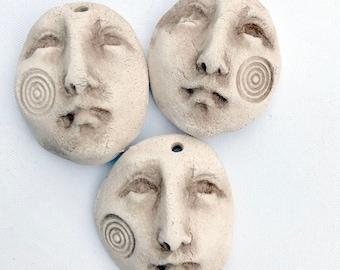 Tres Santos - a curated trio of natural earthenware faces