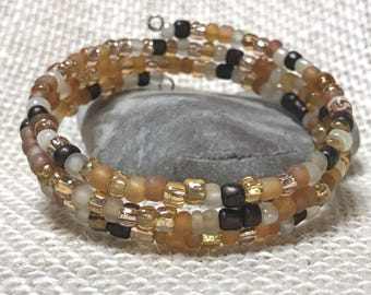 Memory wire stackable adjustable bracelet: shades of gold and white.