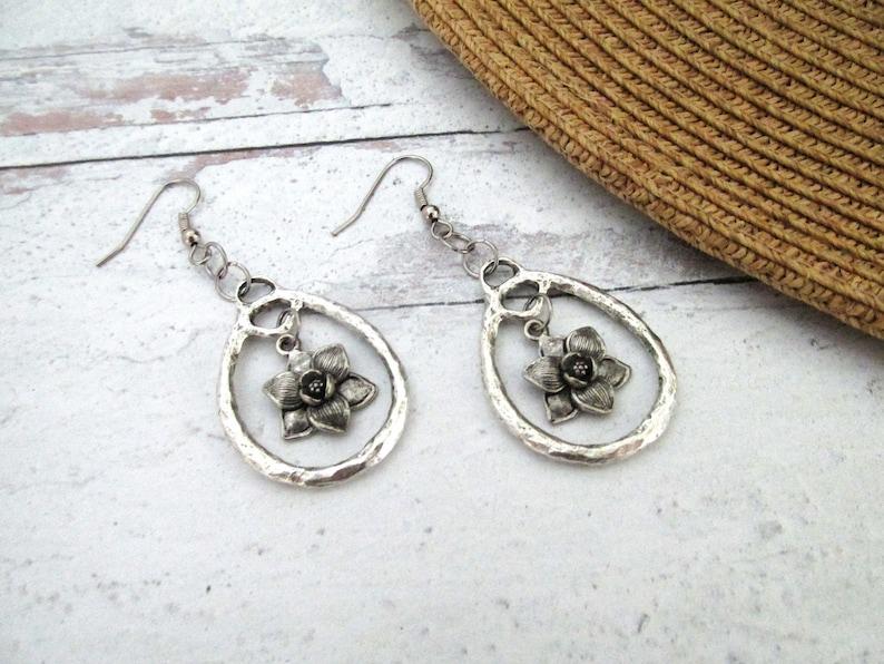 hammered hoop earrings with pewter magnolia leaf charm