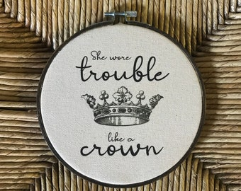 She wore trouble like a crown hoop art printed on canvas choice of fabric color stained or plain wood hoop