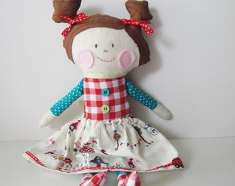 Stuffed soft cotton fabric doll with brown hair and pigtales
