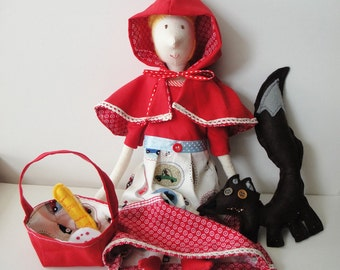 Stuffed fabric doll little red riding hood with brown wolf