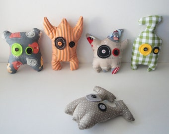 Colorful stuffed monsters from outer space with cotton