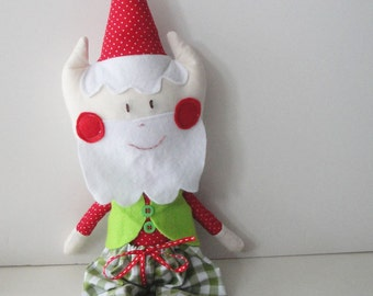 Christmas elf Santa claus with green vest and checkered green pants