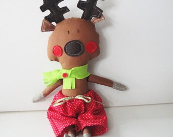 Christmas reindeer with green scarf and red pants