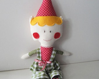 Christmas elf soft stuffed toy with blonde hair and checkered pants