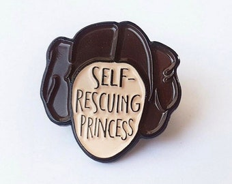 Self Rescuing Princess Soft enamel pin from UK guest artist Bookish and Bakewell.