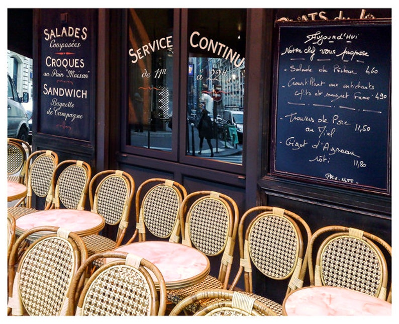 Paris cafe photography print with bistro chairs and marble tables.