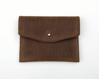 69d9edd72b8 Handmade envelope purse simple design in  Coach Grain  linear textured  brown leather Sam Browne stud fastening stitching for cards coins