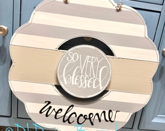 Gray wreath door hanger with stripes and hand lettering interchangeable