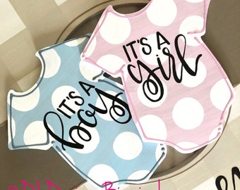 Baby onesie its a boy its a girl door hanger attachments hand lettered