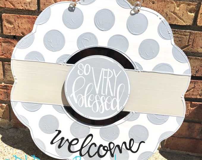 Gray and white wreath door hanger with polka dots and hand lettering interchangeable