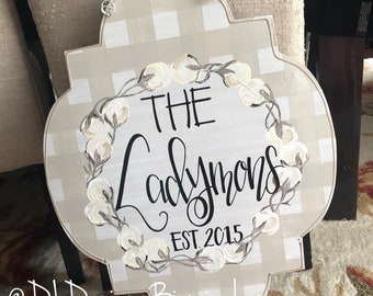 Cotton wreath door hanger with personalized handlettered gingham neutral