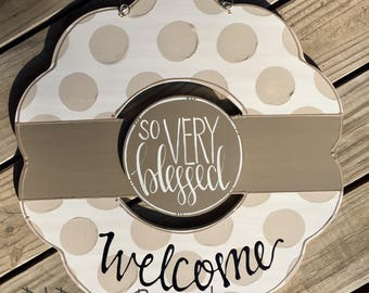 neutral wreath door hanger with polka dots and hand lettering interchangeable