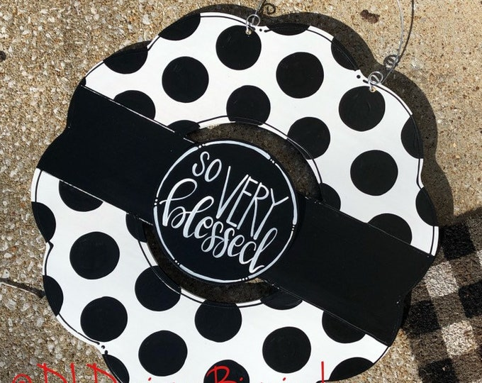 Black and white wreath door hanger with polka dots and hand lettering interchangeable