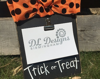 halloween picture frame with trick or treat and ribbon