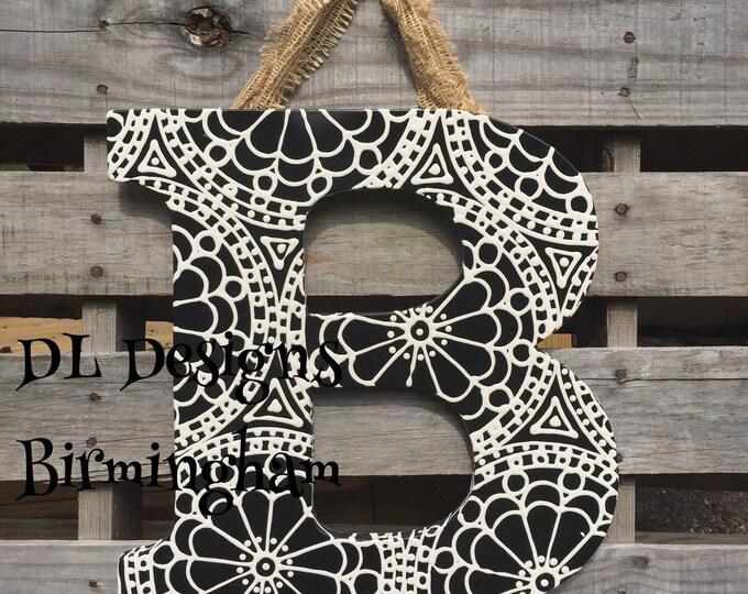 Block letter initial door hanger with medallion year round door hanger neutral