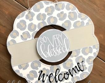 Leopard print wreath door hanger neutral hand lettering interchangeable gray