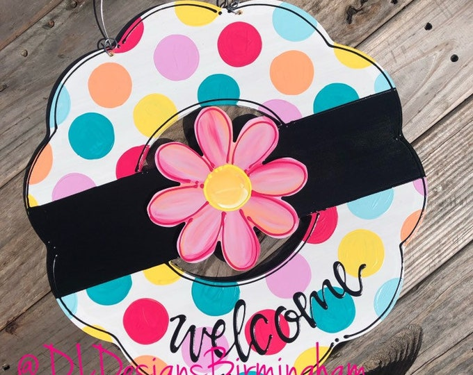 Bright wreath door hanger with polka dots and hand lettering