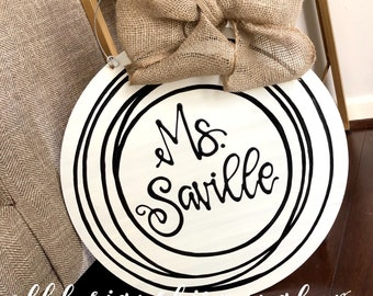 Personalized neutral door hanger hand lettered circle wedding gift last name cream and black