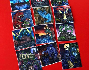 Set of 12 Stickers featuring the Mill City Monster Series by Tracy Levesque - Each sticker is 2x2""