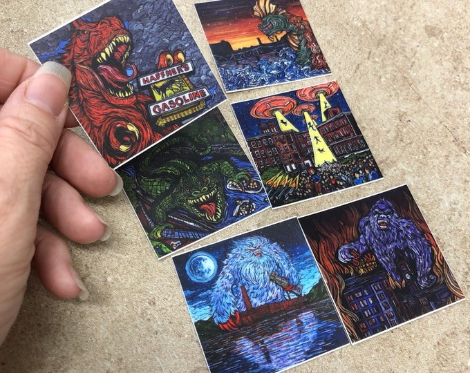 """Set of 6 Stickers of the Mill City Monster Series by Tracy Levesque - Each sticker is 2x2"""""""